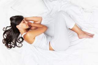 What Does Your Sleeping Position Say About You? Foetal position